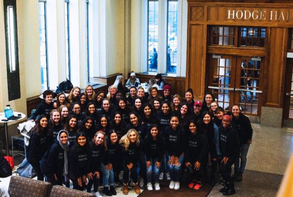 A group of women at the Kelley School of Business wearing Female Genius Hoodies